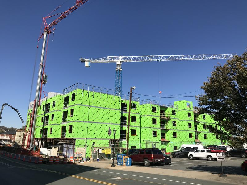 Cranes rise above construction projects on West Main St. in Charlottesville.