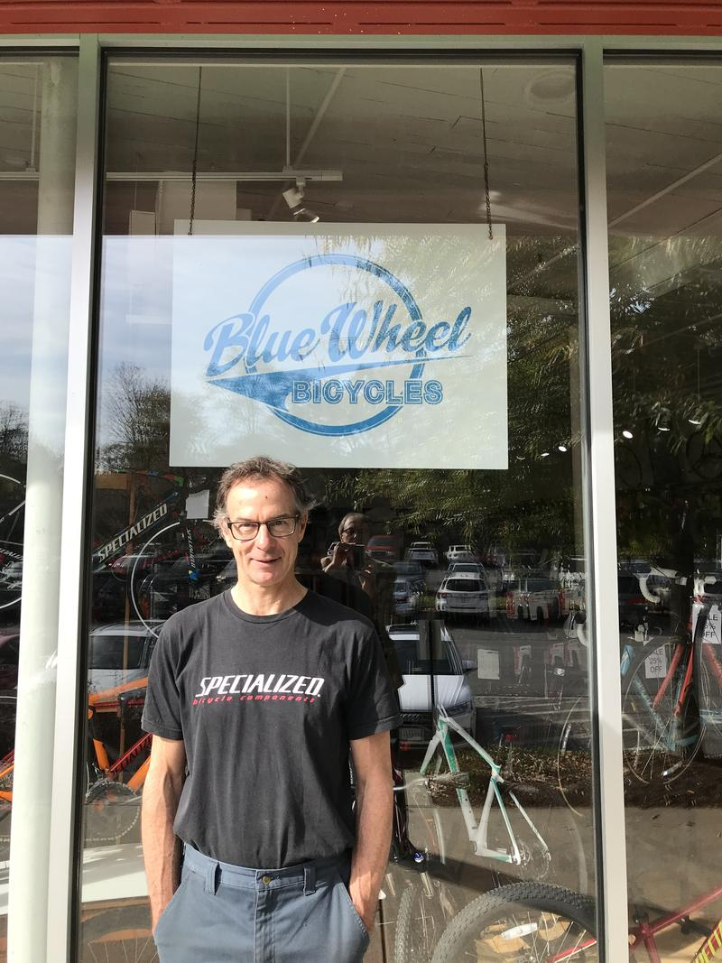 Scott Paisley is owner of Blue Wheel Bicycles, and was a frequent participant in the Streetscape Improvement Plan. (And you might spot reporter Peter Jump's reflection in the window, taking the pic.)