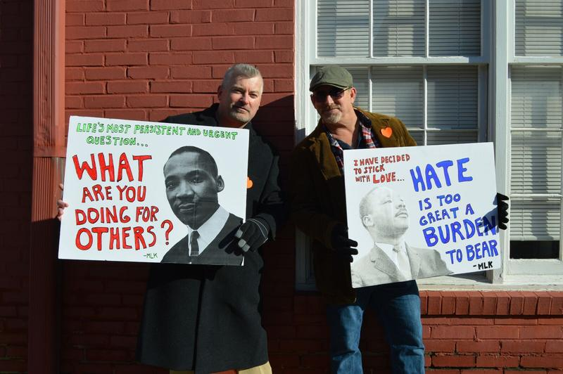 Clinton Gaughran, right, said he came from Los Angeles to march in the MLK Day parade with his Lexington friend, Dennis Ayers.