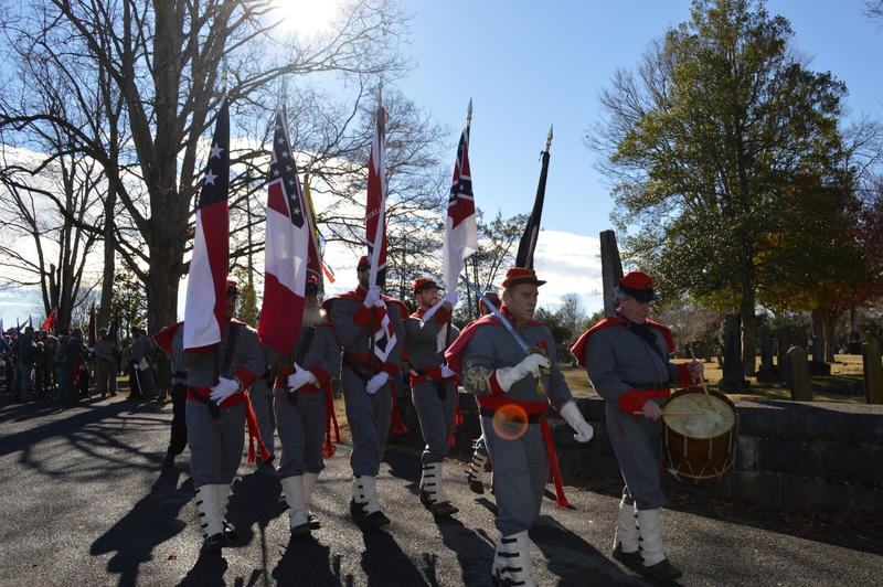 A color guard carrying different iterations of the Confederate flag led the parade through Lexington on Saturday.