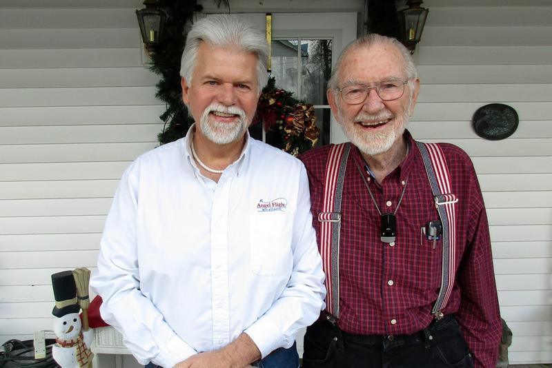 John Billings (right) and Nevin Showman outside of Billings' home in Woodstock.