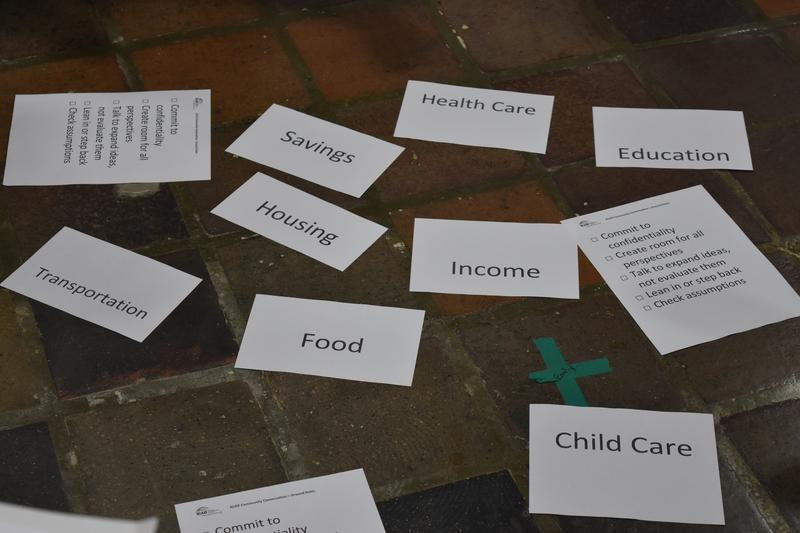 Topic cards are scattered on the floor for groups discussing solutions for ALICE.
