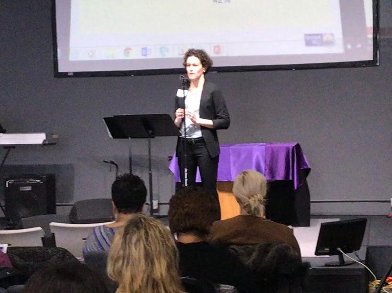 Laura Toni-Holsinger addresses the audience at the ALICE Community Conversation.