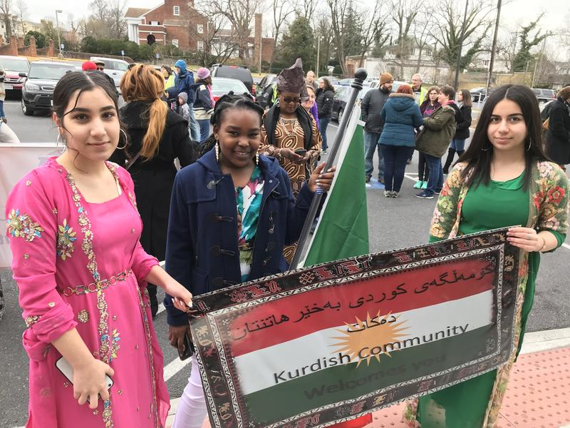 (L to r)  Harrisonburg High School students Areen Quambari, Sabrina Abdula and Shaima Merawly gather before the International Women's Day March starts.