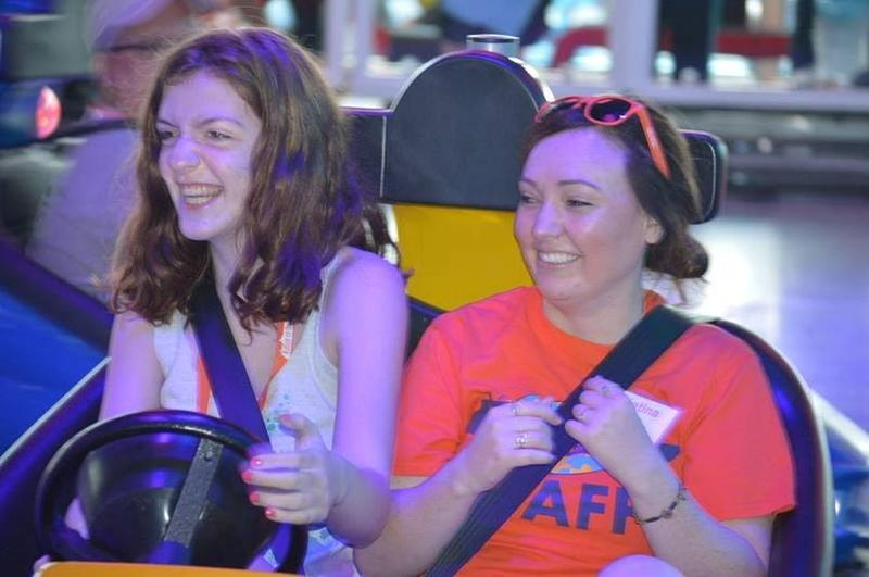 Jules Cayer, 14, tries out the bumper cars with one of Autism on the Seas staffers. Orange shirt-wearing staff members are volunteers who have degrees relating to child development, behavior therapy and/or special education.