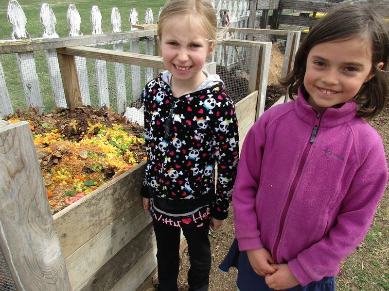 Second graders Ora and Eliza take food scraps to the compost bin every day during recess at Waterman.