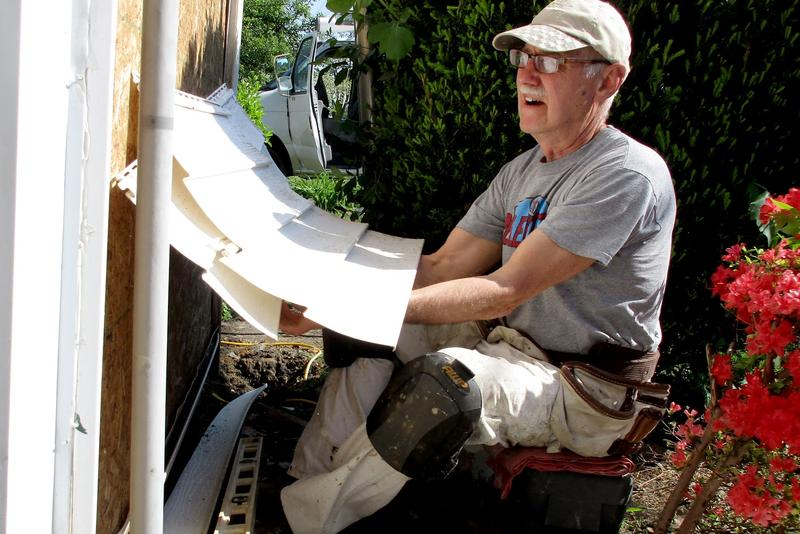 Russ Leinbach, a carpenter volunteering his time to help restore the house.