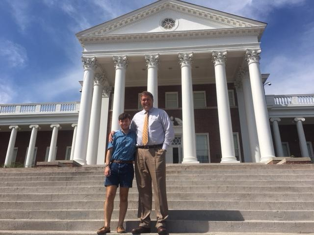 Student Jeremiah Foltz and Principal Mike Dufrene on the steps fronting Handley High School.