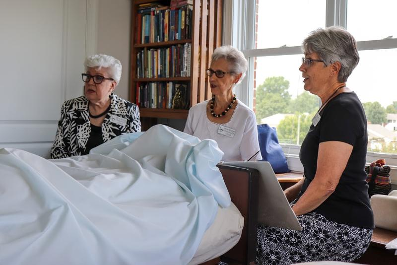 Three members of the Blue Ridge Threshold Choir – (from left) Donna Heatwole, Mamie Mellinger and Mary Glick – sing for resident Preston Nowlin at Virginia Mennonite Retirement Community.