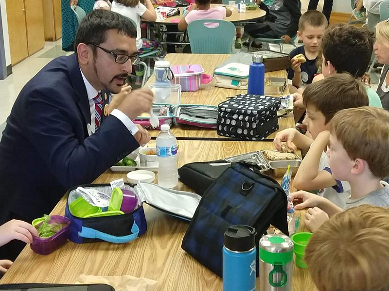 Virginia Secretary of Education Atif Qarni visited Venable School on Thursday, and had lunch with second graters to enjoy a locally-sourced meal.