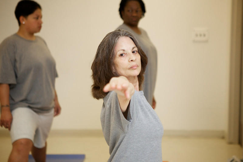 The non-profit Common Ground Healing Arts has been offering yoga classes to inmate at a local women's prison since 2009.