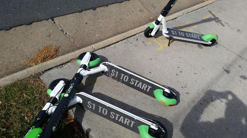 Lime scooters left on a sidewalk on Reservoir St.