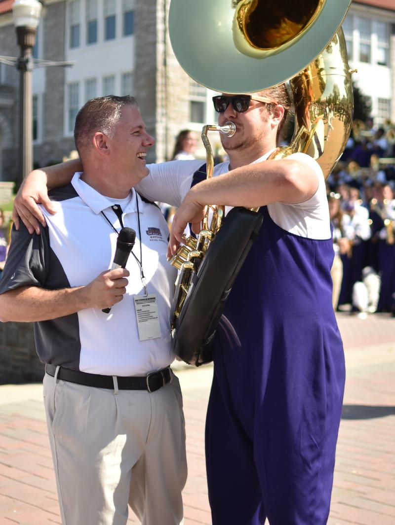 Dr. Scott Rikkers and Foote horse around recently during a Marching Royal Dukes event on campus.