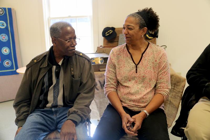 Veterans Sam Matthews and Janice Johnson joke around.