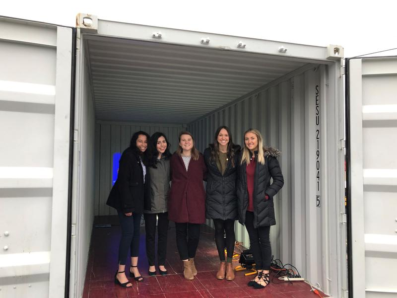 Students from the Community Innovations class show off the container for use to help provide medical care for homeless people on the streets of Harrisonburg.