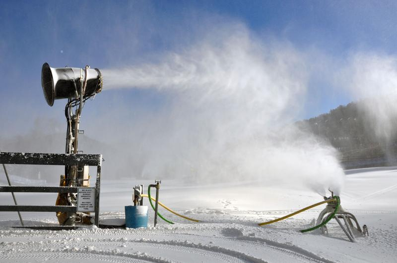 A Ratnik snow gun turns forty gallons of water every minute into fine, white snow drifting down onto a ski trail at Massanutten Resort.