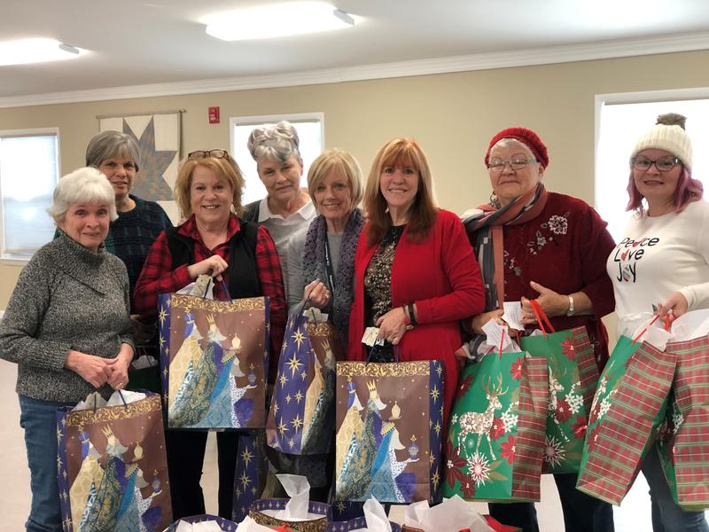 The semi-weekly knitters group (l to r): Phillis Bauer, Norma O'Flaherty, Lynn Hoy, Meki Schifflett, Mary Sue Banks, Marilyn Jarrells, Ada Jones and Tina Wright