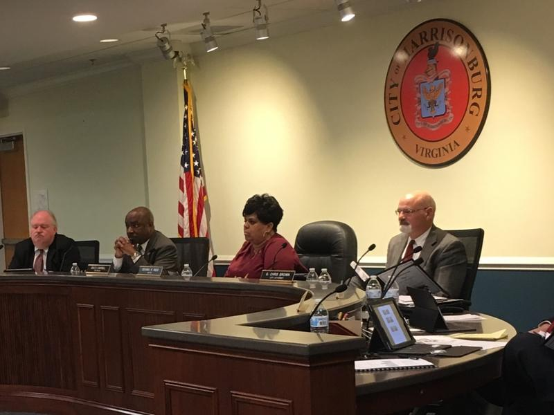 (L to r) Councilmen Richard Baugh and Chris Jones, Mayor Deanna Reed, and City Attorney Chris Brown at a recent Harrisonburg city council meeting.