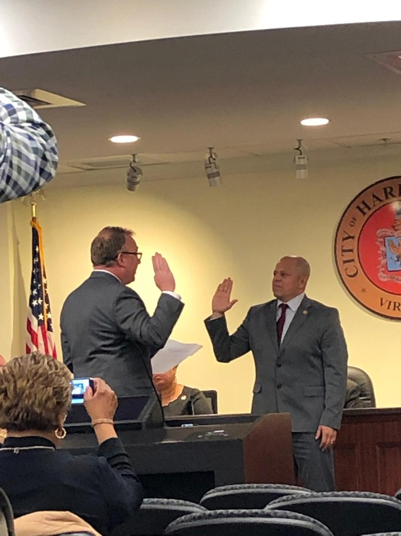 Chaz Haywood, Clerk of Circuit Court, swears in City Councilman Sal Romero on Wednesday.  Councillors chose Romero, elected in November, as vice mayor.