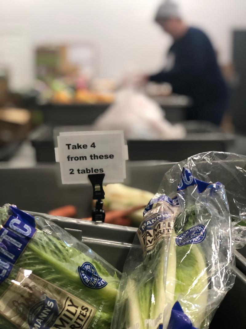 Shoppers are encouraged to take whatever veggies they need, in English and Spanish.