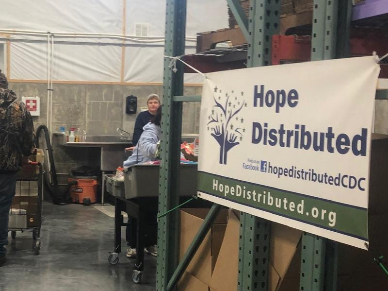 Shoppers choose their food at the Hope Distributed Food Pantry.