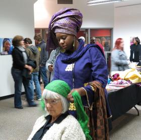 Zarinah El-Amin Naeem helps Janet Clawson try out a few styles