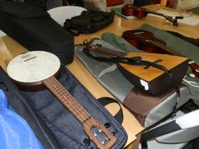 Some of the group's ukuleles. James Powers says there is quite a variety of ukuleles today.