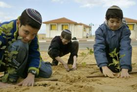 Isreali children plant trees in the Gaza Strip before Tu Bshvat in 2005.