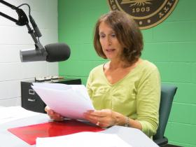 Deborah Gang reading from one of her poems in WMUK's Studio B.