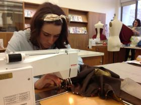 Clowie Rinehart uses a sewing machine to stitch together one of her Egyptian inspired dresses.