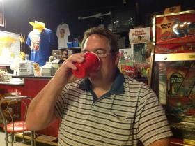 Kevin Ketchum drinking some of his homebrewed Klassic Rootbeer at Klassic Arcade.
