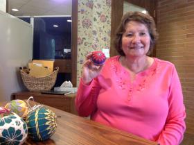 Ethy Denardo holds up one of her favorite temari balls that she's made.