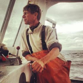 "Captain Chip Zeiner at the wheel of the ""Helen D"""