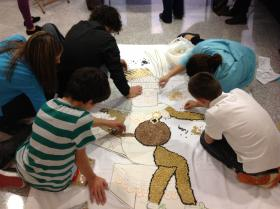 WMU Department of Spanish faculty and friends help make the mural of Tlaloc, the Aztec god of rain