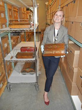 Andrea Melvin, the collections curator at the Grand Rapids Public Museum, holds an old Bissell Sweeper