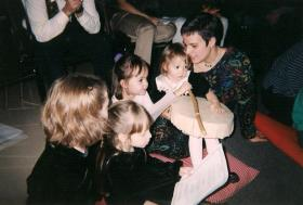 Michele Richards with her daughters Rowan Renstrom-Richards and Sage Renstrom-Richards at the first solstice ritual at People's Church in 2001. Emerald Haan and Cassidy Haan are in the foreground.