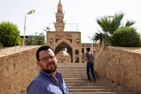 Ben Lando on the steps to the Tomb of Jonah in Mosul