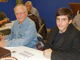 Numismatic club members George and his grandson Andrew