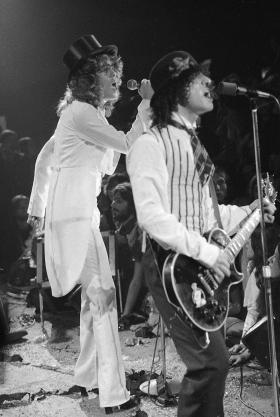 "Rock group ""The New York Dolls"" perform at the Waldorf Halloween Ball, Waldorf-Astoria Hotel, NYC, Oct. 31, 1973. At left is lead singer David Johansen, with guitarist Sylvain Sylvain."