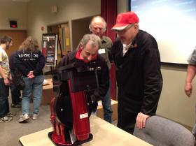 Members of the Kalamazoo Astronomical Society gather round to check out their latest purchase, a $13,000 telescope mount