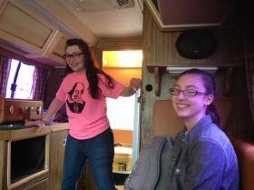 Carol Zombro and 8th-grade-actor Emma Ferguson ride along in the Argosy