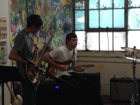 Bassist Malachi Cox (left) and guitarist Kevin Rice (right)