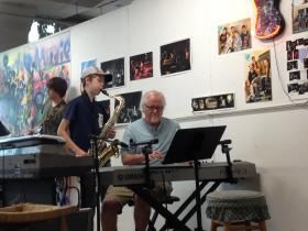 Kalamazoo Academy of Rock instructor Jeff Mitchell takes over on piano while Owen Edwards, 14, does a saxophone solo. Edwards is the youngest member of the band but has been in the academy since he was just 9 years old.
