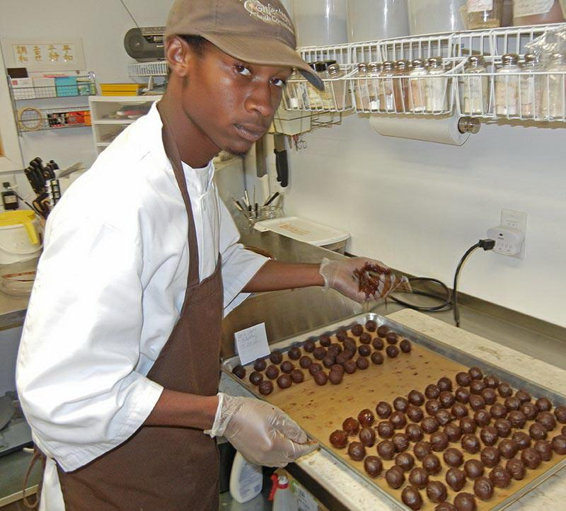 Quinton Mitchell making Truffles at Confections With Convictions.