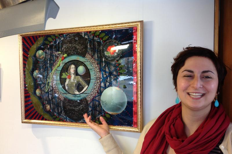 Artist Eana Apple Agopian points out different pieces in her collage