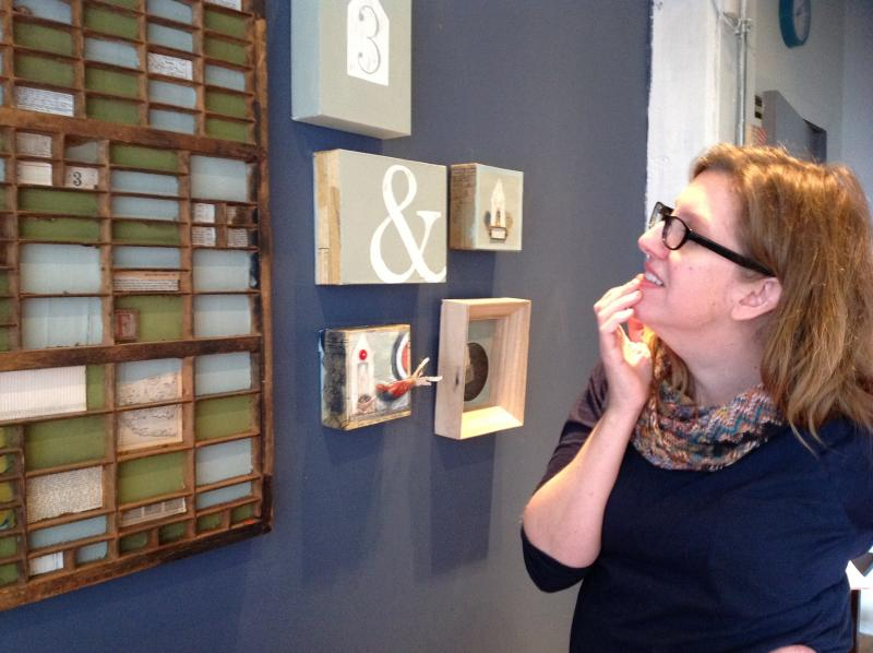Artist Bonnie Pfingst looks over one of her works in progress. It's made from an old printing tray.