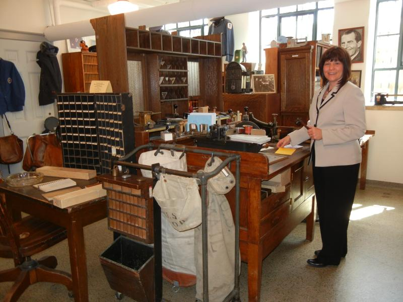 Marshall Post Master Beth Martin in the post office museum