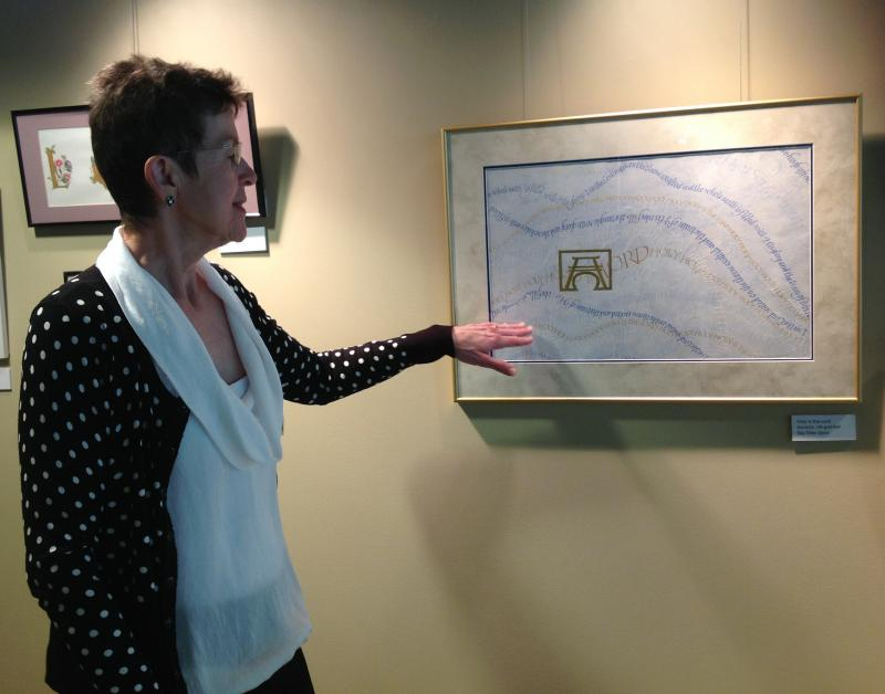 Kay talking about her piece made to look like the flowing robes of Christ.