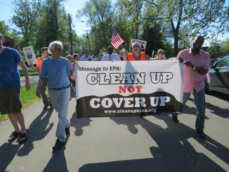 File photo: Kalamazoo City Commissioner Don Cooney and Kalamazoo residents march to protest capping the Allied Paper Landfill, May 2013.