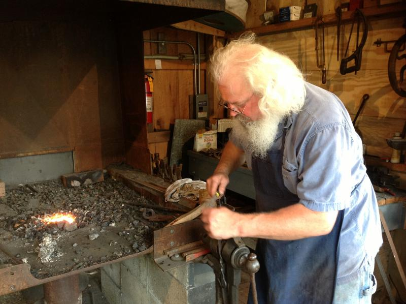 Blacksmith Ted Guimond puts the finishing touches on a meat fork.